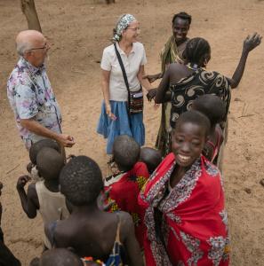 Philip and Linda Byler visit with Laarim villagers